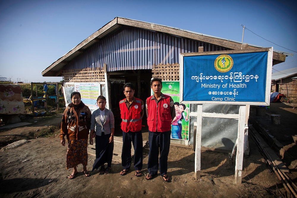 Medical staff at an IDP camp near Sittway, Myanmar pause to be photographed outside their mission.  Recent tension in Myanmar have forced thousands of ethnic Rohingya Muslims into makeshift camps.