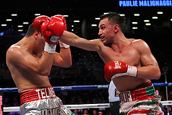Oct 20, 2012; Brooklyn, NY, USA; WBA welterweight champion Paul Malignaggi (white with fringe trunks) and Pablo Cesar Cano (Green/Silver trunks) during their 12 round non-title bout at the Barclays Center.  Malignaggi won via split decision.