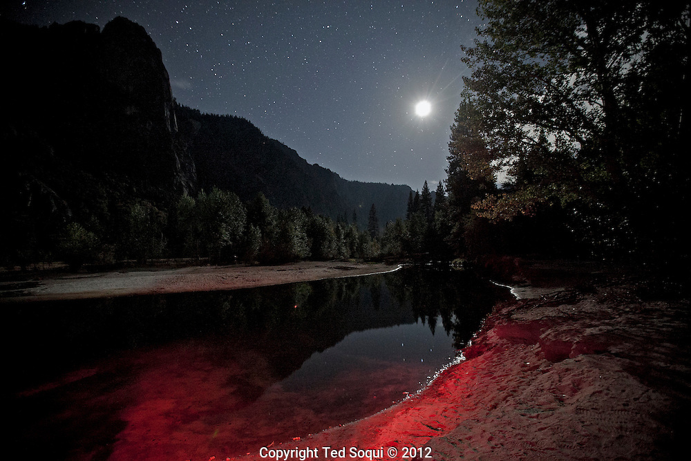 The Merced river at night..The autumn season in Yosemite National Park. Leaves and grasses all around the park are changing to their fall colors, and rain and snow are beginning to fall.