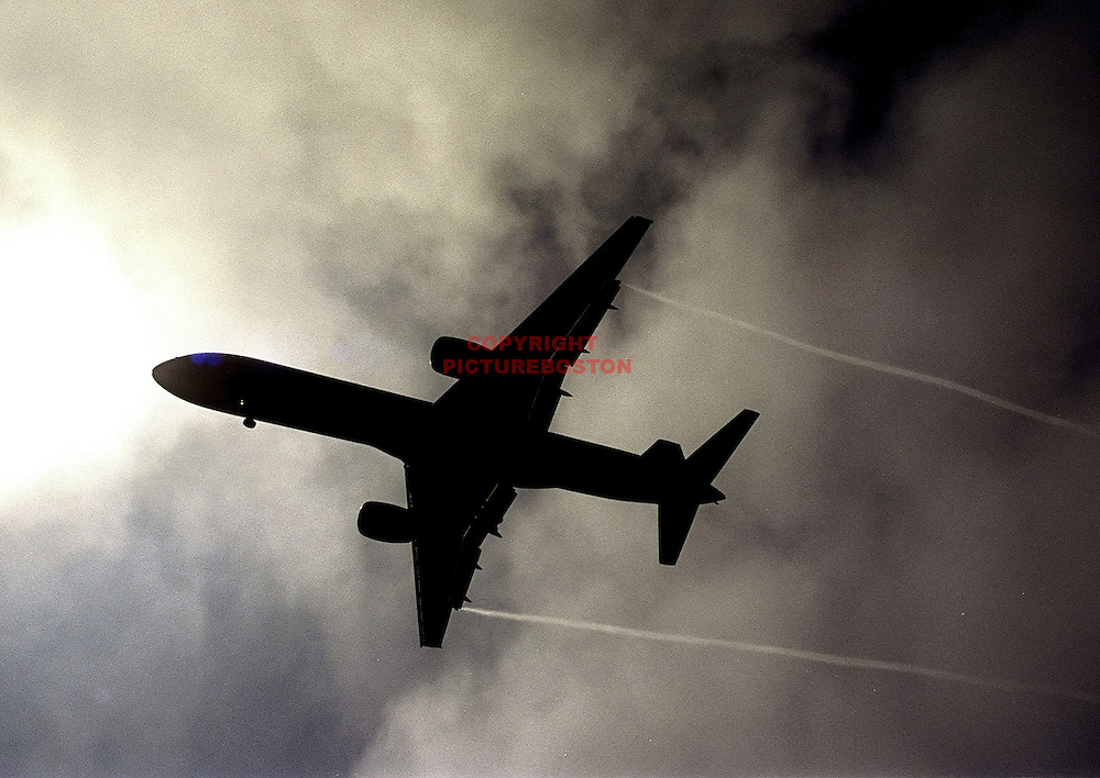 """Various airliners flying in and around Boston's Logan International Airport. Very long lens. NO trickery or photoshop. All photos are """"real time"""" with no trickery or multiple exposure. Here, a 757...."""