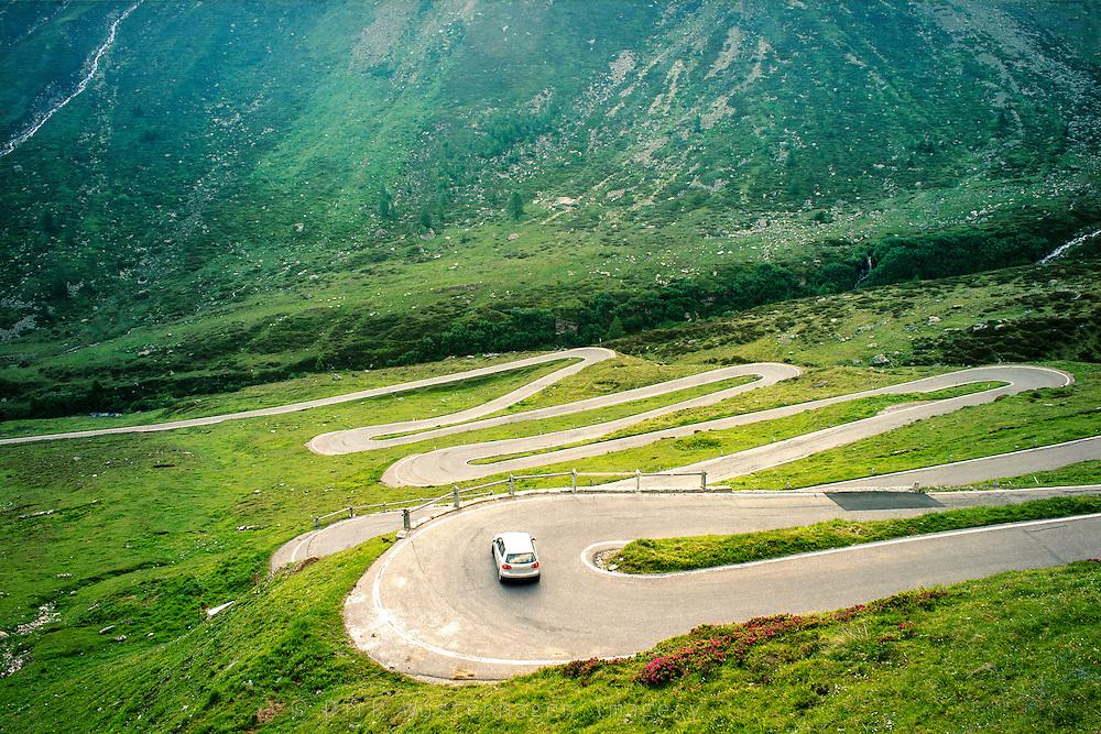 Country road winding up to Spluegen Pass / Swiss-italian border.