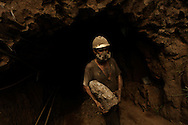 Ametista do Sul, RS, Brazil, 28/02/2008, 10h21: Searching for amethyst, a semiprecious stone, miners dig tunnels through the mountains in southern Brazil. This kind of mining is known for its  harmful dust.  The silicon dioxide particles can trespass the filter masks causing silicosis disease. Over 50% of amethyst miners had developed the silicosis, a disease that has only one cure: Lung transplant..(photo: Caio Guatelli)