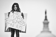 A young girl stands on a ledge to greet people as they make their way to the National Mall from Union Station on January 21, 2017 in Washington, DC, for the Women's March on Washington. Photo by Pete Marovich/UPI
