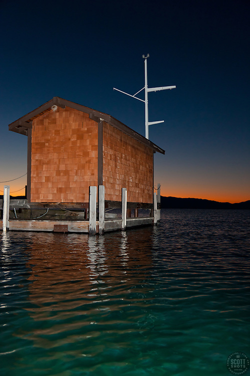 """Tahoe City Pier at Sunrise 1"" - This small building on the end of a pier was photographed at sunrise near Commons Beach, Lake Tahoe. Photographed from a kayak."
