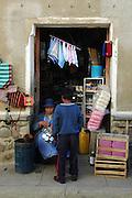 Boy buying a cup in the Tarabuco market, Chuquisaca, Bolivia