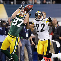 Green Bay Packers' Jordy Nelson hauls in a touchdown pass from Aaron Rodgers while defended by Pittsburgh Steelers' William Gay in the 1st quarter. .The Green Bay Packers played the Pittsburgh Steelers in Super Bowl XLV,  Sunday February 6, 2011 in Cowboys Stadium. Steve Apps-State Journal.