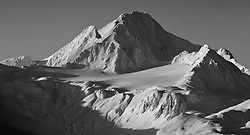 Four Winds Mountain near Haines, Alaska and near the border with Alaska and British Columbia, Canada is bathed in afternoon sunlight. The mountain can be seen from the Alaska Chilkat Bald Eagle Preserve.
