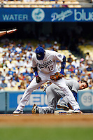 22 August 2009: Second baseman Orlando Hudson checks the base between his legs to see that Cub player #27 Sam Flud is safe after trying to steal a base during the MLB National League Chicago Cubs 2-0 loss to the Los Angeles Dodgers at Chavez Ravine.