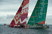 CAMPER with Emirates Team New Zealand slides past Groupama. In Port Race Galway Ireland. Volvo Ocean Race 2011-2012. 7/7/2012