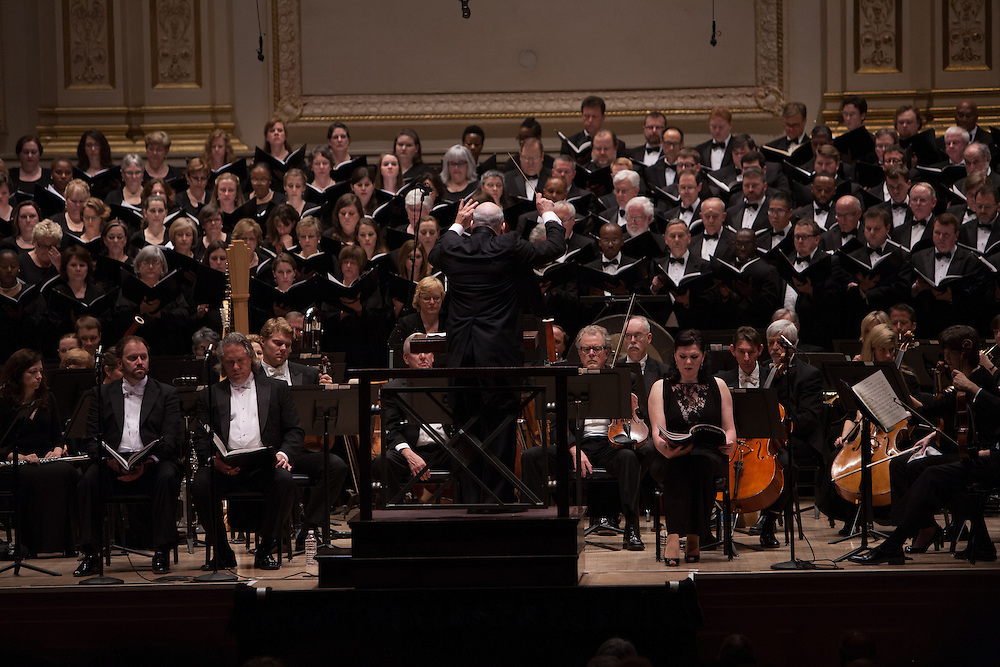 Music Director and Conductor Robert Spano leads his Atlanta Symphony Orchestra and Chorus performing Britten's War of Requiem at Carnegie Hall in New York, NY on April 30, 2014.