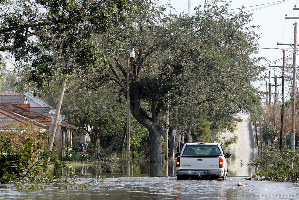 A truck drives through a flooded street Wednesday, August 31, 2005, in New Orleans, La. Scott Morgan