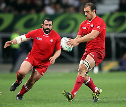 Georgia's Mamuka Gorgodze, right, looks to chip the ball down field against England in the Rugby World Cup pool match at Otago Stadium, Dunedin, New Zealand, Sunday, September 18, 2011. Credit:SNPA / Dianne Manson.