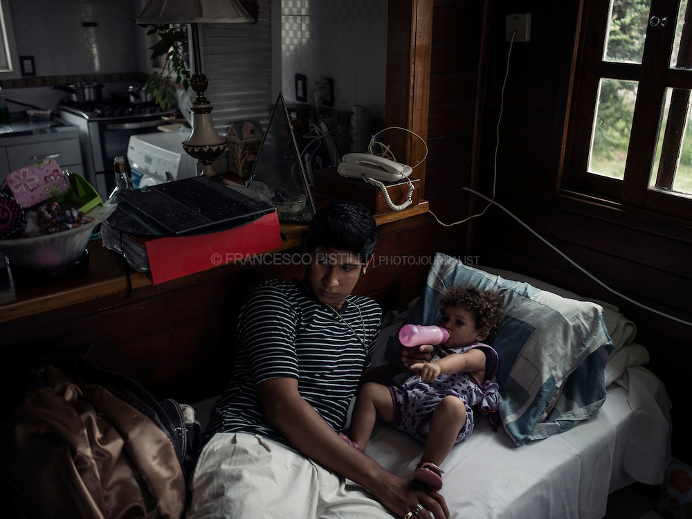 Franco (18) and Helena Maria (2) at home. <br />