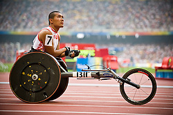 """Chinese athlete waits for the 4x100m T53-54 race start during the Beijing 2008 Paralympic Games at the National """"Bird's Nest"""" Stadium on the 8th September 2008;"""