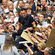 PIC BY GEOFF ROBINSON PHOTOGRAPHY 07976 880732. geoffrey492@btinternet.com<br /> <br />  Picture shows Bruce Springsteen signing autographs and waiting for the power to start up again at  AccorHotels Arena in Paris,France on July 11th  after his concert was halted for 20 minutes when a fuse blew and cut the power.<br /> <br /> Springsteen was singing his hit Ramrod when a fuse blew and the arena lost all lighting and sound.<br /> <br /> The emergency lighting came back on after a few minutes, but there was no sound for 20 minutes as the crew tried to get the power working again.<br /> <br /> The band's drummer played a rhythmic beat as Springsteen apologized to his 10,000 fans for the interruption.<br /> <br /> The rock star then spent time signing autographs and chatting with fans at the front of the stage.