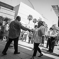 Within a few feet of exiting the LA Convention Center which serves as a makeshift federal courtroom for the large naturalization ceremonies, new Americans begin to run a gauntlet of Republican and Democratic party activists intent on registering them.