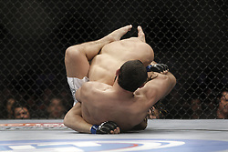 Dec 12, 2009; Memphis, TN, USA; Johny Hendricks and Ricardo Funch during their bout at UFC 107 at the FedEx Forum in Memphis, TN.  Hendricks won via unanimous decision.
