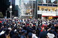 Marchers participate in a  silent march down Fifth Avenue  ''to shop for justice,'' in the police shooting incident that killed Sean Bell and wounded two of his friends on his wedding day in New York, December 16, 2006. ..PHOTO BY KEITH BEDFORD<br />
