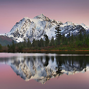 Alpenglow over Mount Shuksan (9131 feet, 2783 meters) seen from Picture Lake, Heather Meadows Recreation Area, North Cascades Washington