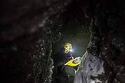 Kiya Riverman logs survey readings on her expedition to map an ice cave in Larsbreen, Svalbard.