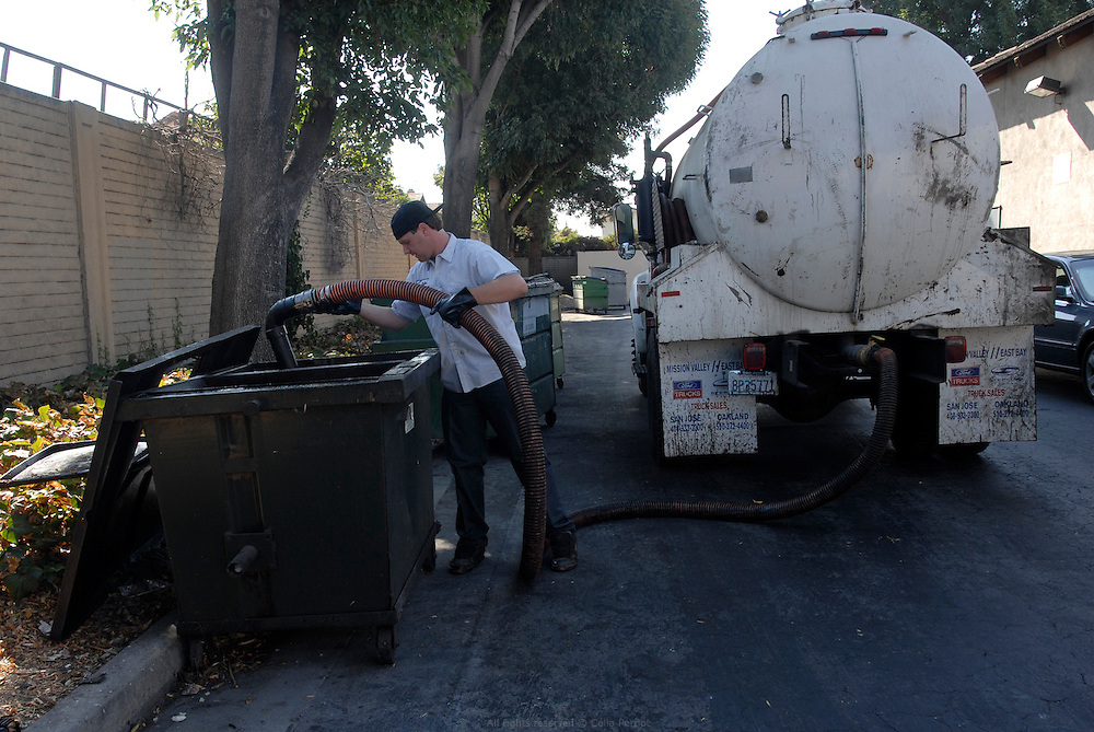 """Waste vegetable oil collect by San Jose Tallow Cie. .Restaurants store their used oil in specific containers. The used oil is then vacuumed and transported by truck to be filtered at San Jose Tallow Cie recycling site. This family owned business started in 1929 was contacted by plants owners in 2006 to collect and filter the """"yellow grease""""..California, USA, September 2008"""