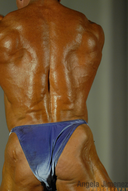 Chris Filippelli, of Fort Lauderdale, Florida, poses during the Physique (bodybuilding) competition 40-49 year old age group heavyweight division at McGaw Memorial Hall/Welsh-Ryan Arena at Northwestern University in Evanston, Illinois during the Gay Games VII competition on July 19, 2006. <br /> <br /> <br /> Filippelli won the modified championship in his division. <br /> <br /> Over 12,000 gay and lesbian athletes from 60 countries are in Chicago competing in 30 sports during the Games from July 15 through 22, 2006. <br /> <br /> Over 50,000 athletes have competed in the quadrennial Games since they were founded by Dr. Tom Wadell, a 1968 Olympic decathlete, and a group of friends in San Francisco in 1982, with the goal of using athletics to promote community building and social change. <br /> <br /> The Gay Games resemble the Olympics in structure, but the spirit is one of inclusion, rather than exclusivity. There are no qualifying events or minimum or maximum requirements.<br /> <br /> The Games have been held in Vancouver (1990), New York (1994), Amsterdam (1998), and Sydney (2002).