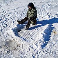 Ice fishing   on Lake Monona Bay in Madison, Wisconsin.