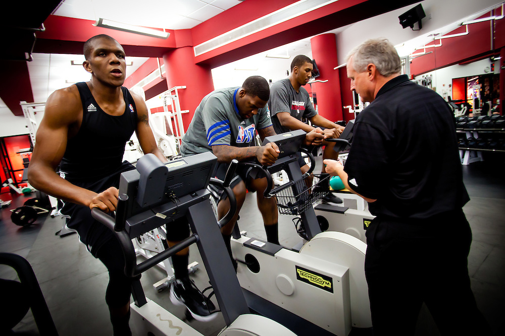 MIAMI, FL -- January 29, 2012 -- Miami's James Jones, left to right, Dexter Pittman, and Terrell Harris work out in the gym in the locker room after the Heat's 97-93 win over the Chicago Bulls at American Airlines Arena in Miami, Fla., on Sunday, January 29, 2012.  (Chip Litherland for ESPN the Magazine)