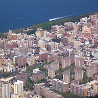 Aerial view of Manhattan's upper west side, with glimpse of Hudson River