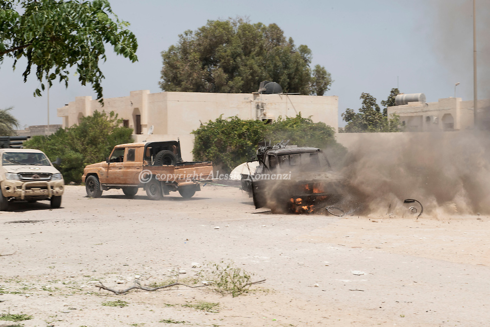 Libya: an ISIS destroyed car is pulled away from the frontline by Libya's Government of National Accord's (GNA). Alessio Romenzi