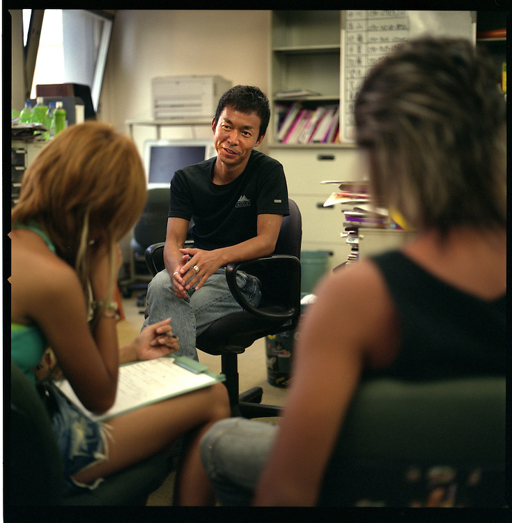 "Kouichi Nakagawa, editor in chief of Egg Magazine,  interviews walk-in ""ko-gal"" and ""gal-O"" model prospects at his editorial office, Shibuya, Tokyo, Japan.  Egg Magazine taps into the ""ko-gal"" and ""gal-O"" market."