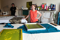 Textile designer Arin Arthur talks about the screening process. Angie Bowling Sebolt, Belinda Isley, and Arin's shared studio was one of the venues on Jodi Eichelberger's ST(r)EAM Artist Studio/Gallery bike tour in the Surel Mitchell Live-Work-Create District in Garden City, Idaho on June 18, 2016.<br />