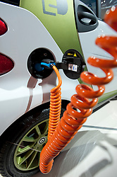Plug in electric SMART car being recharged at the Frankfurt Motor Show 2009