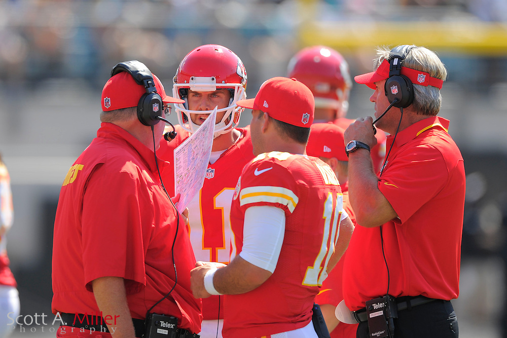 Kansas City Chiefs head coach Andy Reid talks with quarterback Alex Smith (11), quarterback Chase Daniel (10) and Offensive Coordinator Doug Pederson on the sidelines during the Chiefs 28-2 win over the Jacksonville Jaguars at EverBank Field on Sept. 8, 2013 in Jacksonville, Florida. The <br /> <br /> &copy;2013 Scott A. Miller