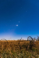 The planet trio of Venus (brightest), Jupiter (above Venus) and Mars (dim and red to the left of Venus), all in Leo in the morning sky on November 1, 2015, with the waning gibbous Moon illuminating the landscape and sky. The stars of Leo, including Regulus, shine above the planets.<br /> <br /> This is a stack of 4 x 30-second exposures at f/5.6 and ISO 2000 for more depth of the field for the ground, plus a 10-second exposure at f/2.8 and ISO 2000 to minimize star trailing. The ground exposures were mean combined in a stack to smooth noise. Diffraction spikes added with Astronomy Tools Actions for Photoshop.