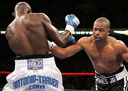 Roy Jones Jr.(r) and Antonio Tarver (l) trade punches during their third fight for the World Light Heavyweight Championship at the St. Pete Times Arena in Tampa, FL.