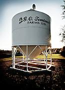 A grain bin is captioned with the farmer's business name, Birch Hills, Saskatchewan.