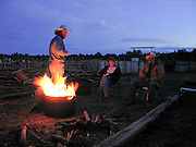 07 MAY  2004 -- WILLIAMS, AZ: Cowboys around the campfire on the Willaha Ranch, north of Williams, AZ, May 7, 2004. The ranch is in the high desert country near the south rim of the Grand Canyon. The ranch is in the high desert country near the south rim of the Grand Canyon. Arizona ranchers are in the midst of a ten year draught that has dramatically reduced the size of their herds. At the same time, public consumption of beef has soared because of the popularity of the Atkins and other high protein diets, so while prices are up, herd yields are down because of the drought.  PHOTO BY JACK KURTZ