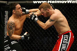 November 17, 2007; Newark, NJ, USA;  Frankie Edgar (black trunks) and Spencer Fisher (red trunks) battle during their bout at UFC 78: Validation at the Prudential Center in Newark, NJ.  Edgar won via unanimous 3 round decision.