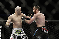 Dec 12, 2009; Memphis, TN, USA; Kevin Burns and TJ Grant during their bout at UFC 107 at the FedEx Forum in Memphis, TN.