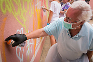08/09/2015 - Lisbon, Portugal: António Rodrigues, 72, paints a wall during the Lata 65 workshop. Lata 65 was project created by Lara Seixo Rodrigues and is a creative workshop teaching street art to senior citizens. (Eduardo Leal)