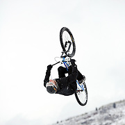 SHOT 2/9/13 1:58:23 PM - A competitor pulls a backflip during practice for the Best Trick Bike event at the second annual Winter Mountain Games presented by Eddie Bauer at Vail Ski Resort in Vail, Co. The Winter Mountain Games feature competitions in X-Country On-Snow Mountain Bike Races, mixed climbing, Telemark Big Air, Best Trick Bike and On-Snow Mountain Bike Crit with more than $60,000 in prize money on the line. (Photo by Marc Piscotty / © 2013)