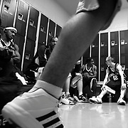 The Salem Stampede rest in the locker room at halftime during a game against the Central Oregon Hotshots in Bend. Photographed March 24, 2006. (Thomas Patterson / Statesman Journal)