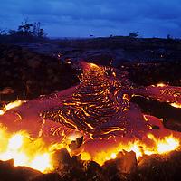 USA, Hawaii, Volcanoes National Park,  Molten lava flows across coastal plain during Kilauea eruption at dusk