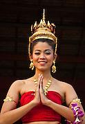 Young Thai woman in traditional costume at Siam Niramit; Bangkok, Thailand.