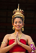 Young Thai woman in traditional costume at Siam Niramit; Bangkok, Thailand.