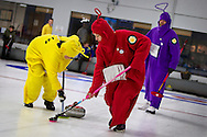 The Teletubby team sweeps the stone at the St. Paul Winter Carnival Bonspiel at St. Paul Curling Club, Saturday, January 25, 2014.