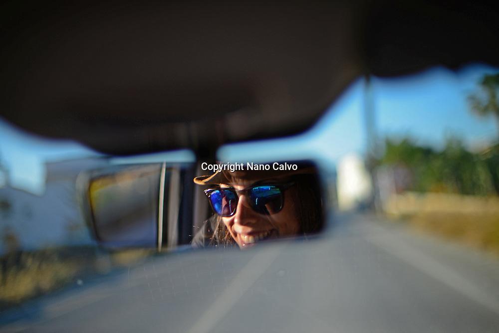 Young woman driving car in Ibiza, Balearic Islands, Spain