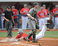 Ole Miss' Will Allen scores on a squeeze play vs. Vanderbilt catcher Spencer Navin at Oxford-University Stadium Stadium in Oxford, Miss. on Sunday, April 7, 2013. Vanderbilt won 7-6 in 11 innings.