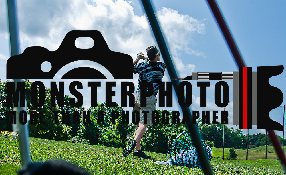 "08/06/11 Avondale PA: Delaware head football coach K.C. Keeler practices his golf swing Saturday Aug. 6, 2011 at Inniscrone Golf Course in Avondale PA...Keeler ""Said he had a great teacher and a great teaching connection with Lori Van Sickle""...The News Journal/SAQUAN STIMPSON"